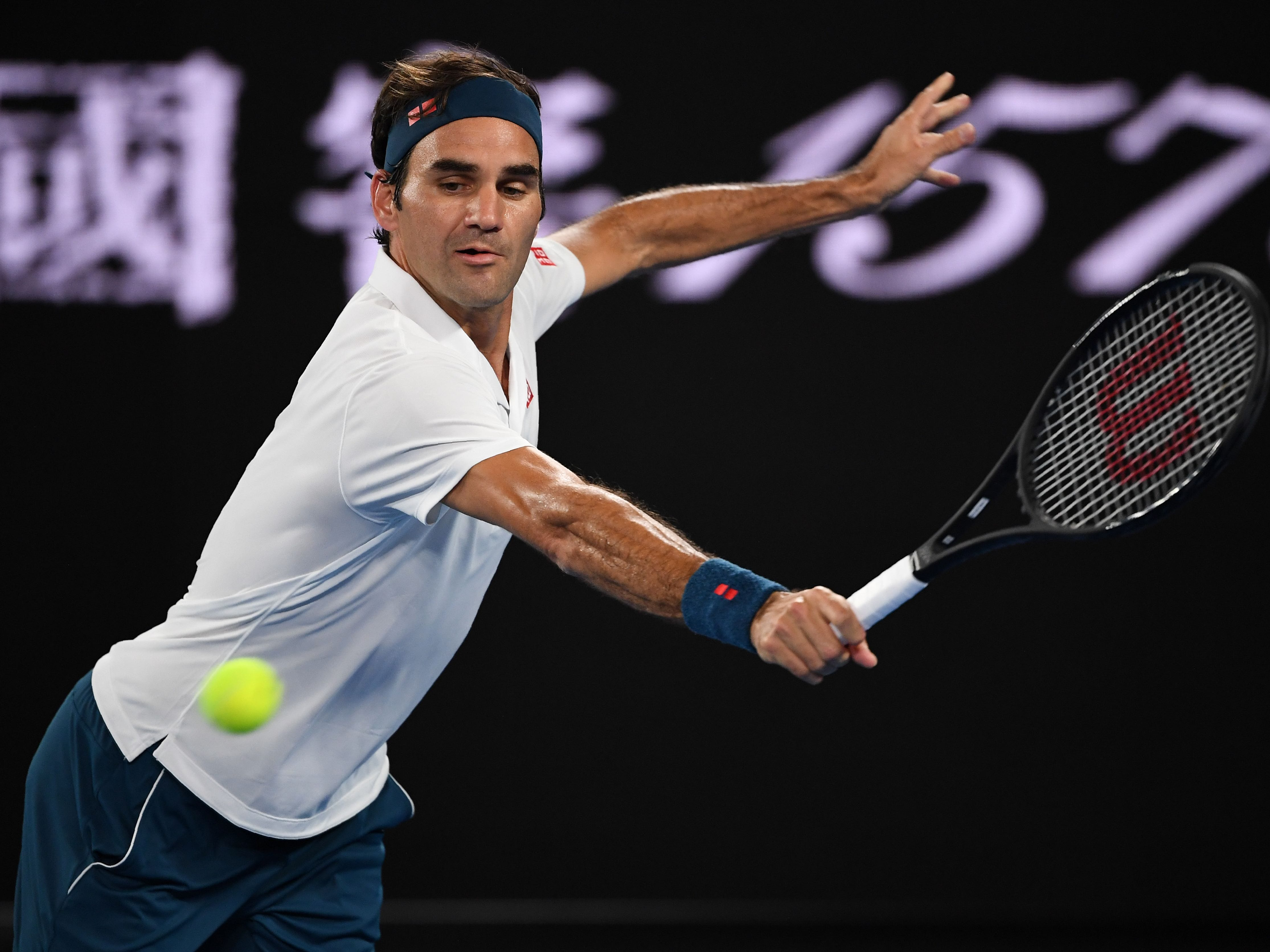 Third-seeded Roger Federer, playing a backhand return against American Taylor Fritz, reached the Round of 16 at a Grand Slam tournament for the 63rd time in his career.