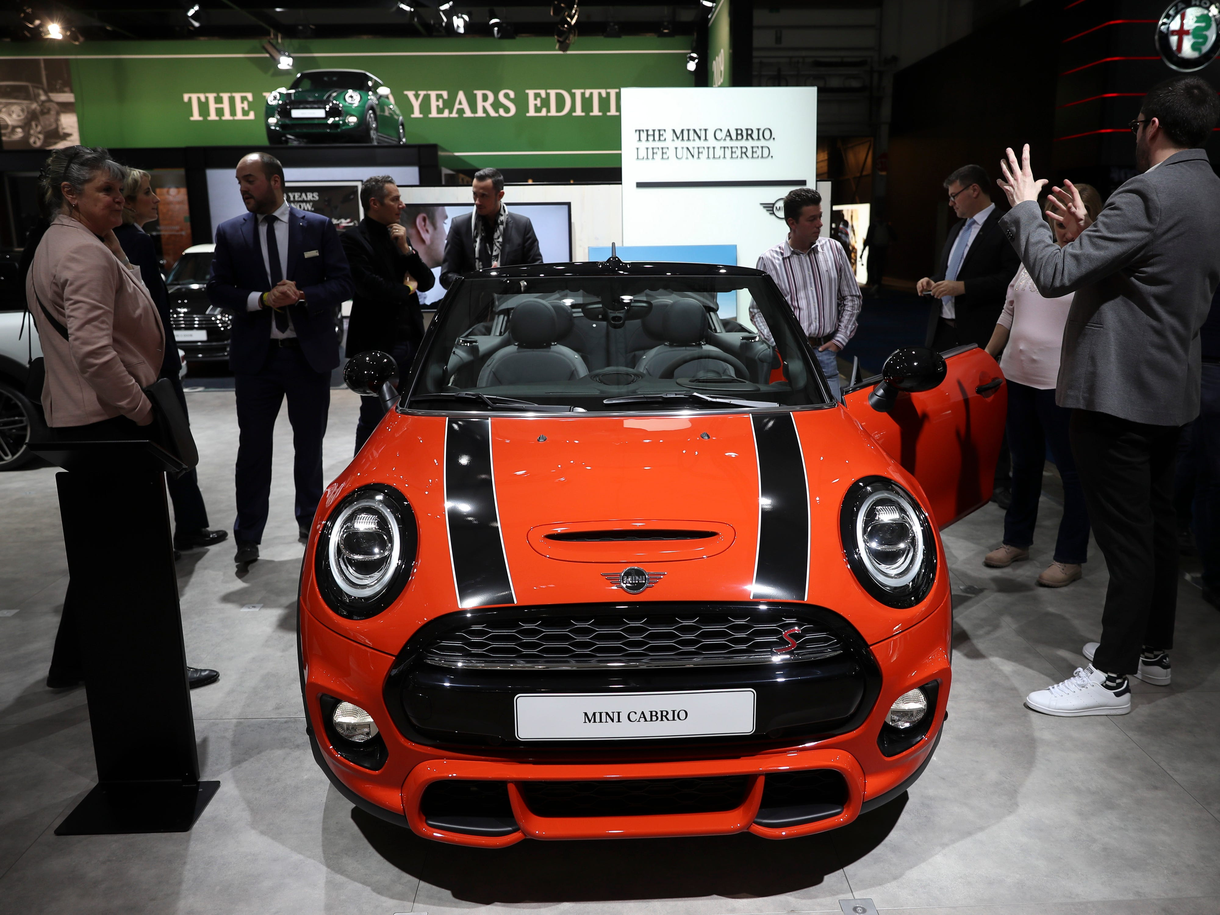 People look at the new Mini Cabrio.