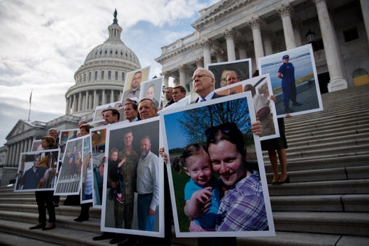 Democratic Senator from Vermont Patrick Leahy (R), Senate Minority Whip Dick Durbin (2-R) and Senate democrats carry photographs of furloughed federal workers during a press conference urging President Trump to reopen the government outside the Capitol in Washington on Jan. 16, 2019. SHAWN THEW, EPA-EFE