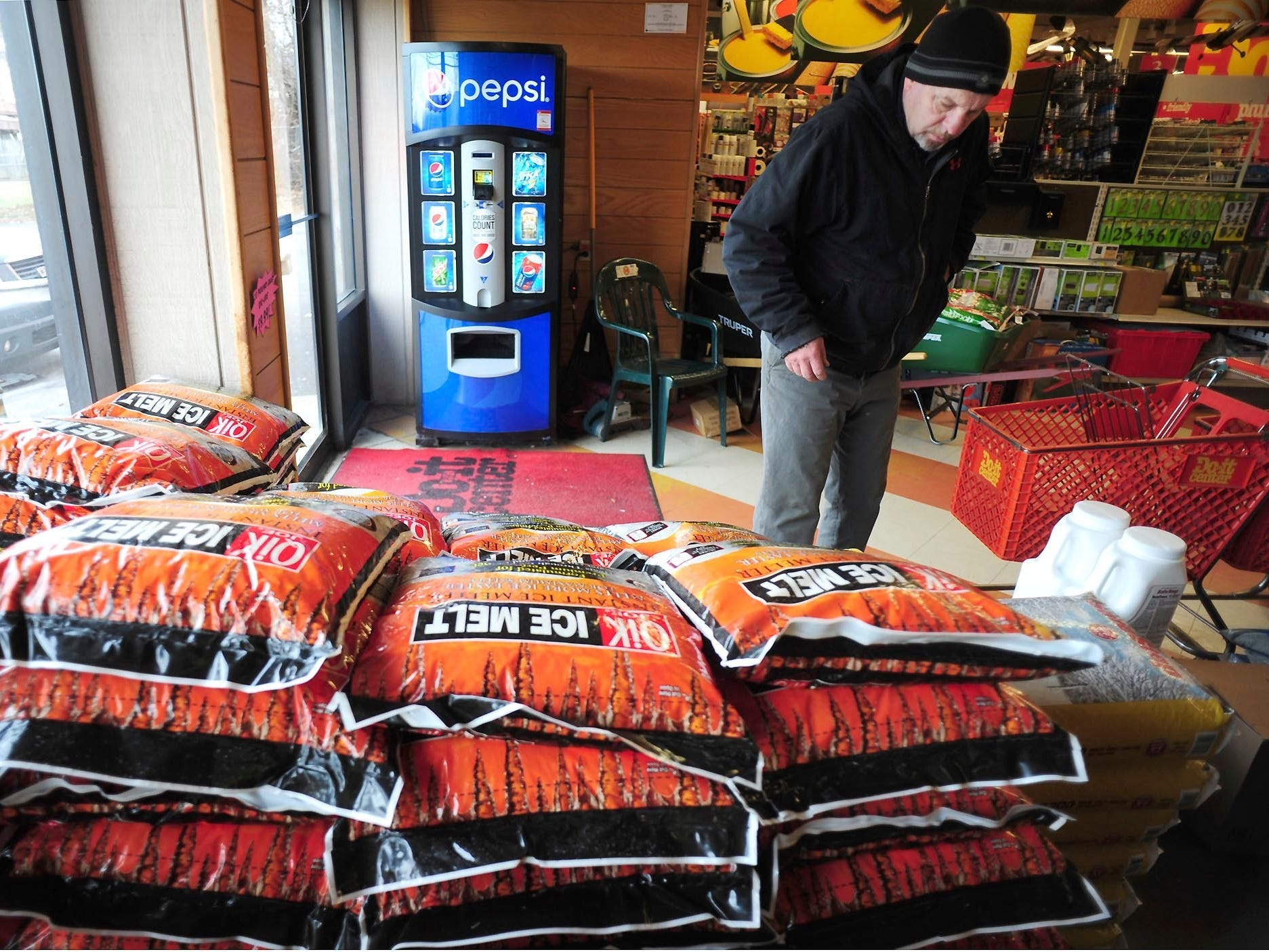 Customers purchase rock salt and ice melt, Jan. 17, 2019, at Walter's Hardware in Wilkes-Barre Township, Pa.