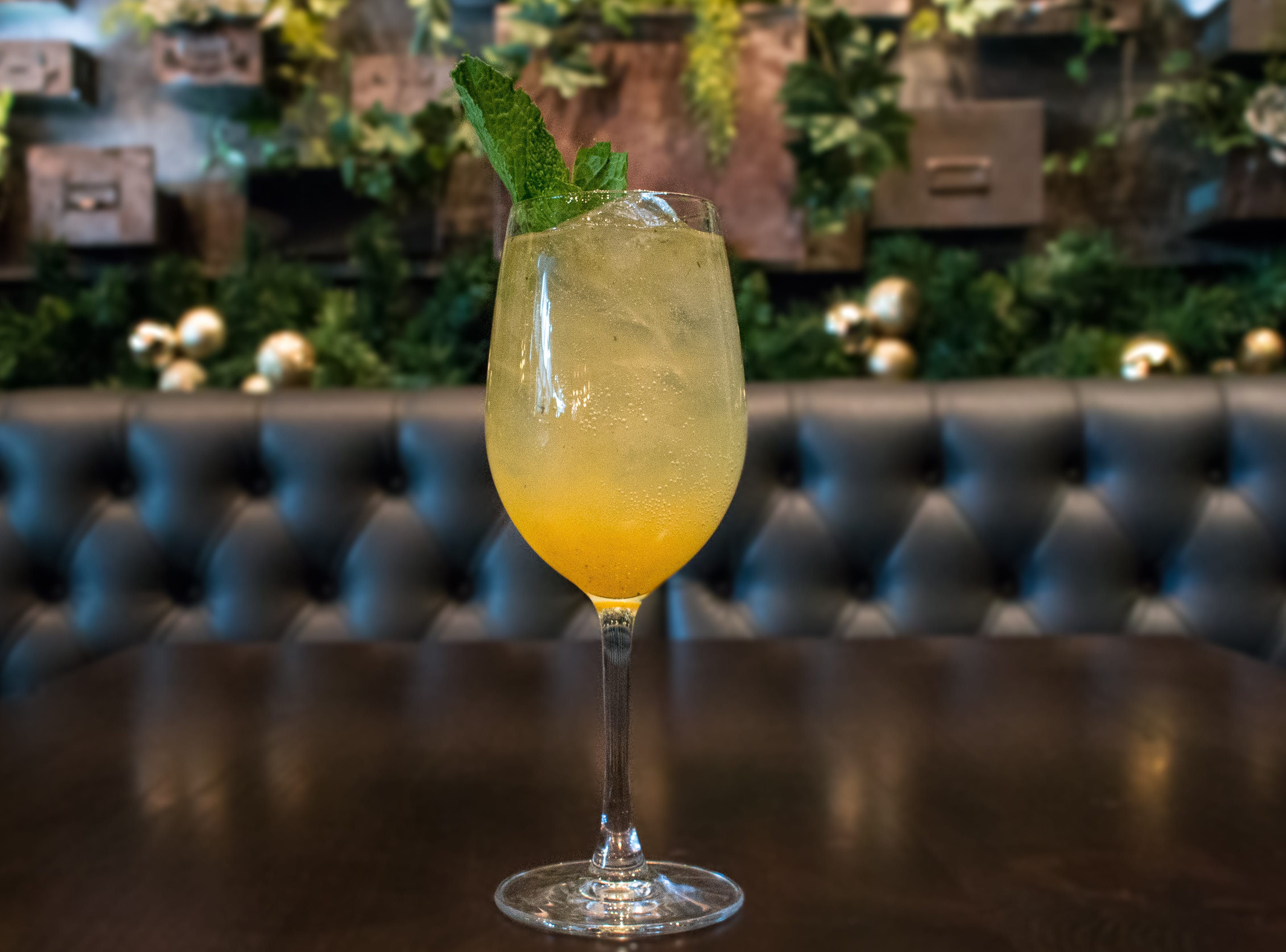The No. -12 at Siena Tavern in Chicago. Its ingredients are peach, lime juice, simple syrup and mint leaves.