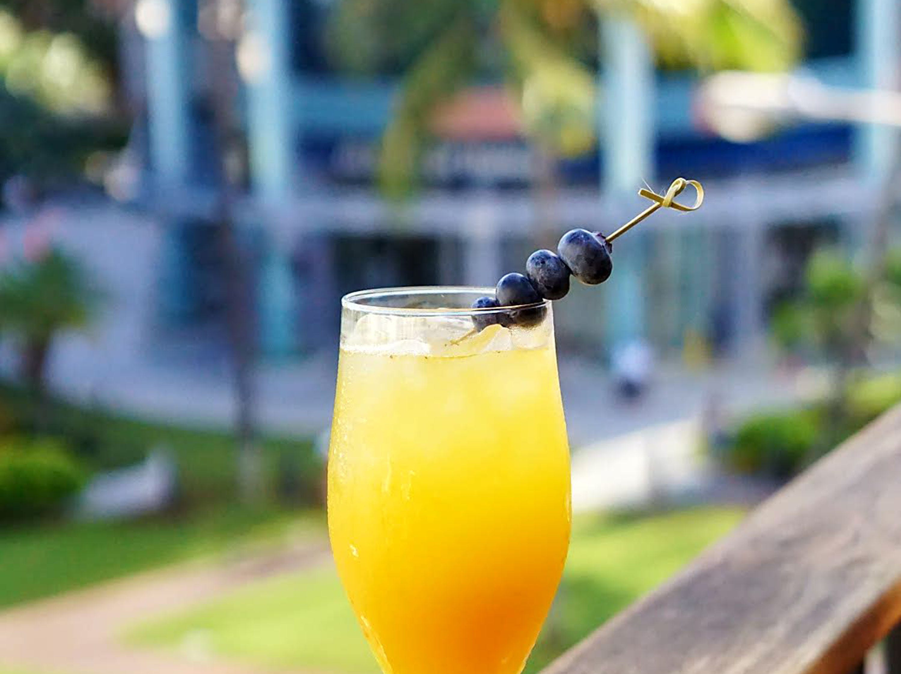 The Blue My Mind at Tommy Bahama with locations nationwide. It's made from muddled blueberries, passion fruit and scratch lemonade.