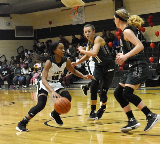 Rapides senior Darlynetta Martin (10) looks to score against Holy Savior Menard High School Friday, Jan. 18, 2019. Martin was named as the MVP of the All-District 4-2A team.