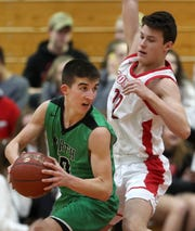 Oshkosh North's Josh Dilling looks for a pass while Neenah's Jacob Dietz defends Friday in Neenah.