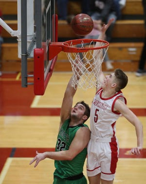 Neenah's Max Klesmit blocks a shot from Oshkosh North's Matt Hickey during a Fox Valley Association game Friday in Neenah.