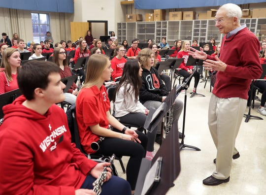 Legendary University of Wisconsin band leader Mike Leckrone talks with band students during a visit to Kimberly High School on Tuesday. Leckrone received the Red Smith Award at the 54th annual Red Smith Banquet.