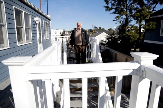 Vince Farias poses outside one of his vacation rental properties in Surf City. New Jersey shore property owners like Farias are bracing for a new tax on their rentals that's beginning to bite just as renters typically start booking their summer vacation spots.