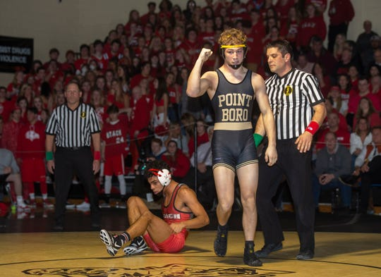 Point Pleasant Boro's Jack Bailey (right) after he pins Point Beach's Anthony Luongo Friday night in Point Boro's 41-26 win