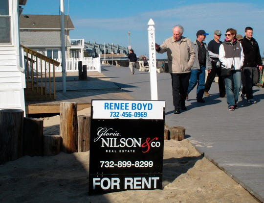 In this 2014 photo, people walk past a home being offered as a summer rental on the boardwalk in Point Pleasant Beach. New Jersey shore property owners and renters worry that a new tax on short-term lodging like Airbnb rentals could hurt the state's shore economy.