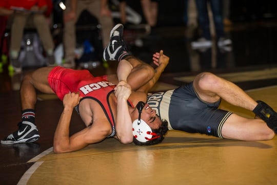 Point Pleasant Boro's Ty Bailey (right) (pins Point Pleasant Beach's Anthony Luongo Friday night in the 145-pound bout of the Panthers' 41-26 win over Point Beach