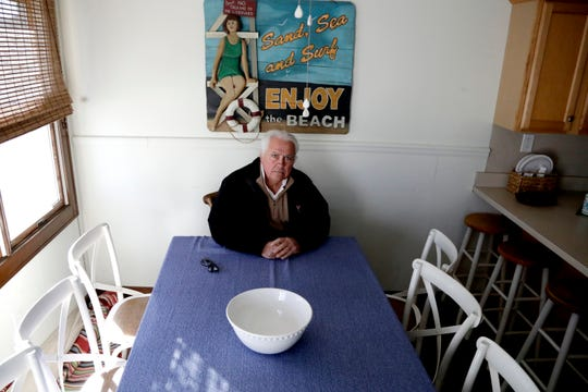Vince Farias poses inside one of his vacation rental properties in Surf City. New Jersey shore property owners like Farias are bracing for a new tax on their rentals that's beginning to bite just as renters typically start booking their summer vacation spots.