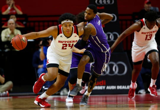 Rutgers Scarlet Knights forward Ron Harper Jr. (24) dribbles the ball against Northwestern Wildcats forward Vic Law (4)