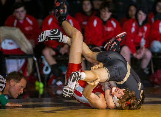 Point Pleasant Boro's Nick Torre pins Point Pleasant Beach's Jonah Bowers in their 113-pound bout Friday night. Point Boro won the match 41-26.