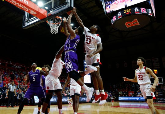 Rutgers Scarlet Knights guard Montez Mathis (23) blocks the shot of Northwestern Wildcats guard Anthony Gaines (11)
