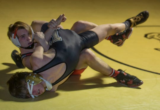 Beach's Riley Simon vs Boro's James Latendorf in their 126 lbs. bout. Point Pleasant Boro Wrestling defeats Point Pleasant Beach in Point Pleasant Boro, NJ on January 18, 2019.