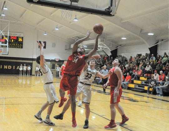 Albany post Coby Knight (34) goes for a shot under the basket against Haskell on Friday, Jan. 18, 2019, at Haskell High School. The Lions beat the Indians 55-35.
