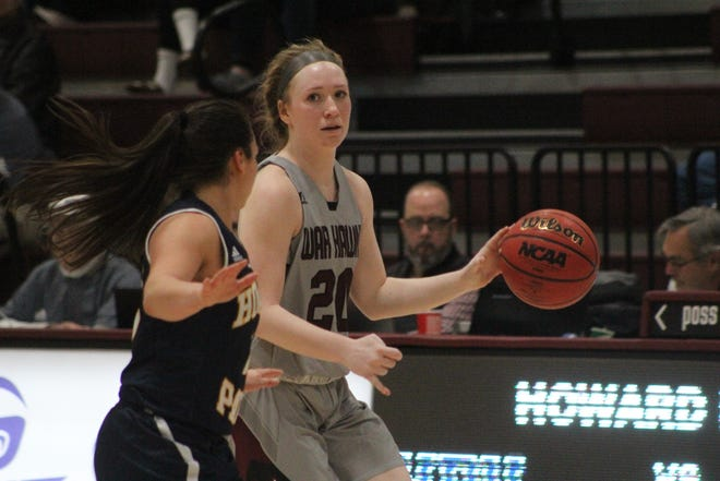 McMurry point guard Sarah Doherty (20) surveys the floor during the War Hawks game against Howard Payne, Saturday, Jan, 19, 2019.
