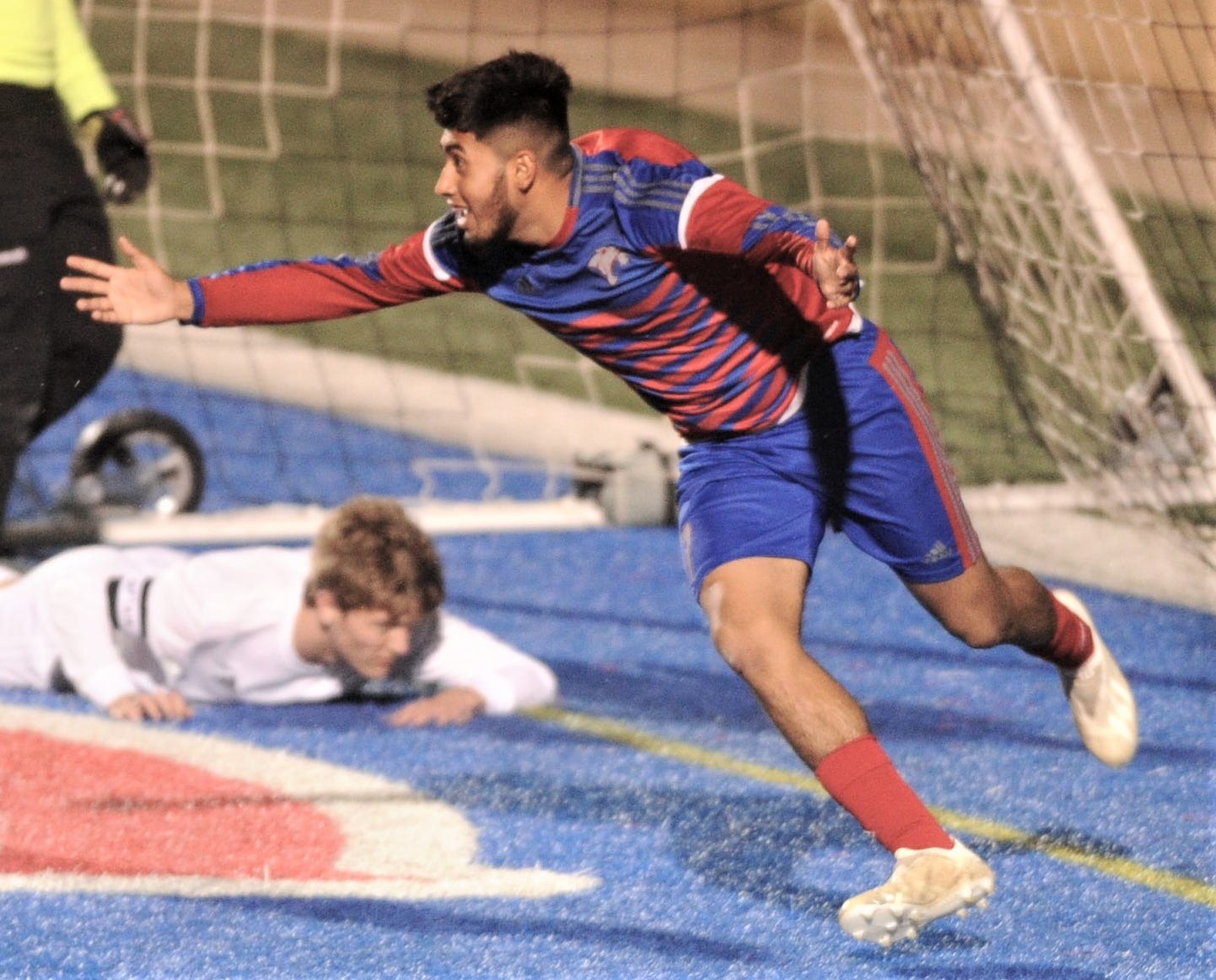 Cooper's Michael Rangel, right, celebrates after scoring the tying goal with 30:33 left in the game against Abilene High on Jan. 18 at Shotwell Stadium. Soccer will move to a new field at Shotwell when a track-and-field complex opens up thanks to the November 2018 bond program, with construction being led by FieldTurf USA Inc., which was approved as top bidder in a special AISD board meeting Monday afternoon.