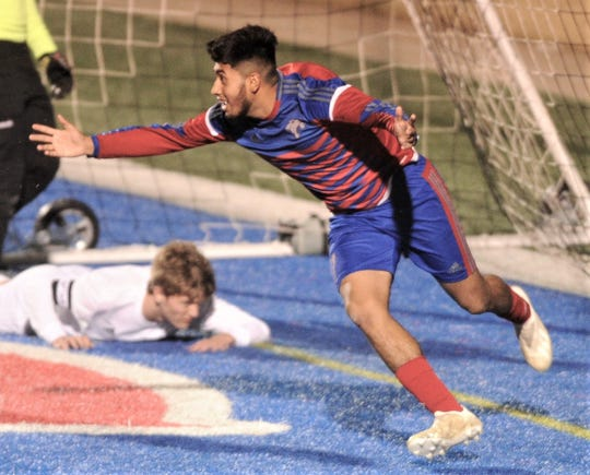 Cooper's Michael Rangel, right, celebrates after scoring the tying goal with 30:33 left in the game against Abilene High. The teams played to a 2-2 tie in the nondistrict boys soccer game Friday, Jan. 18, 2019, at Shotwell Stadium.