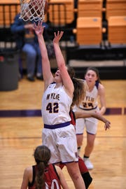 Wylie's Bailey Roberts (42) lays the ball in for a score against Wichita Falls High at Bulldog Gym on Friday, Jan. 18, 2018.