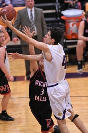 Wylie's Austin Brewer (4) goes to the basket against Wichita Falls High in District 4-5A play at Bulldog Gym on Friday, Jan. 18, 2019.