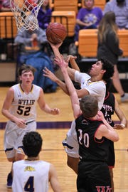 Junior Payton Brooks (32) is one of several first-year starters for Wylie this season. Brooks goes into the playoffs averaging 14.3 points per game and is coming off a 20-point performance against Cooper.