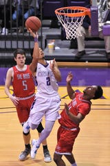 Hardin-Simmons guard Joe Hoeup (2) lays the ball in against Sul Ross State at the Mabee Complex on Saturday, Jan. 19, 2019.