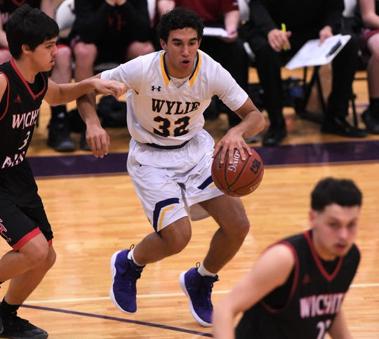 Payton Brooks (32) got the Wylie offense going on Friday night against Wichita Falls High. Brooks scored 18 points, including four 3-pointers in the first quarter to set the tone in the 68-47 win.