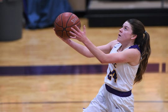 Wylie's Mary Lovelace (24) goes into the air for a layup against Wichita Falls High at Bulldog Gym on Friday, Jan. 18, 2018.