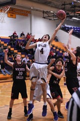 Wylie's Austin Brewer (4) reaches for an offensive rebound against Wichita Falls High in the first meeting between the two teams. The Bulldogs travel to WFHS on Tuesday in the first of two road games this week.