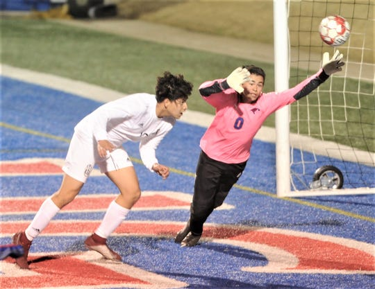Abilene High's Jose Reyes, left, watches has his header sails past Cooper goalie David Damian for the game's first goal with 26:16 left in the first half. The teams played to a 2-2 tie in the nondistrict boys soccer game Friday, Jan. 18, 2019, at Shotwell Stadium.