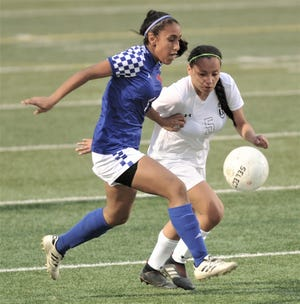 Abilene High's Aliyah Monroe, right, battles Cooper's Lexie Martinez for the ball. The Lady Eagles beat Cooper 1-0 in the nondistrict girls soccer game Jan. 18 at Shotwell Stadium.