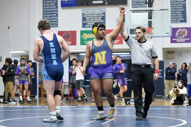 North Henderson's Axel Ortiz is named the winner over Enka's Colby Maxwell in a 220-pound match during their meet at Enka High School on Jan. 18, 2019. Ortiz won by decision 2-1.