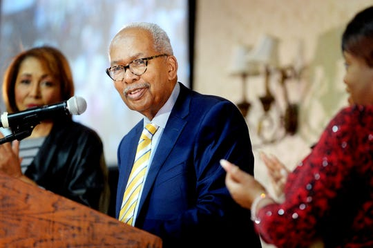 Ernest Green, one of the Little Rock Nine, receives a standing ovation after speaking at the 38th annual Martin Luther King Jr. Prayer Breakfast in Asheville Jan. 19, 2019