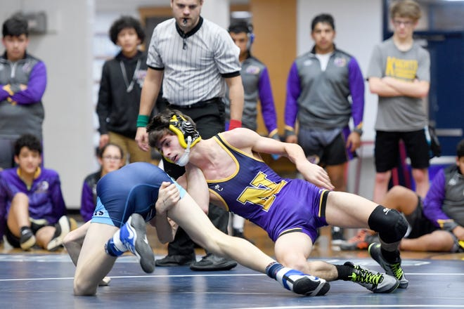 Enka's Greyson Harris wrestles North Henderson's Kyle Randal in a 120-pound match during their meet at Enka High School on Jan. 18, 2019. Harris won by fall at 4:42.