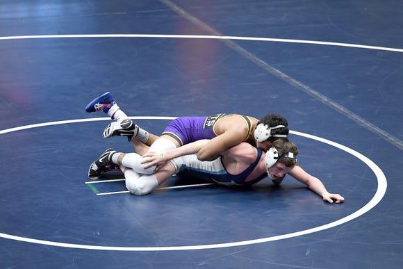 North Henderson's Joshua Feliz wrestles Enka's Willie Howard in a 138-pound match during their meet at Enka High School on Jan. 18, 2019. Feliz won by fall at 1:27.