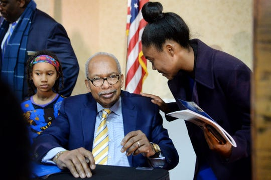 """Karis Price, 18, speaks with Ernest Green, one of the Little Rock Nine, after having him sign her program at the 38th annual Martin Luther King Jr. Prayer Breakfast in Asheville Jan. 19, 2019. """"I thanked him for all that he's done, leading the way for students like me,"""" said the UNC Chapel Hill freshman who was the recipient of a scholarship from the Martin Luther King Jr. Association of Asheville and Buncombe County."""