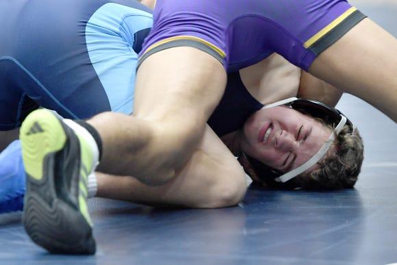 Enka's Carson Turner wrestles North Henderson's Michael Arrona in a 145-pound match during their meet at Enka High School on Jan. 18, 2019. Tucker won by fall at 6:00.