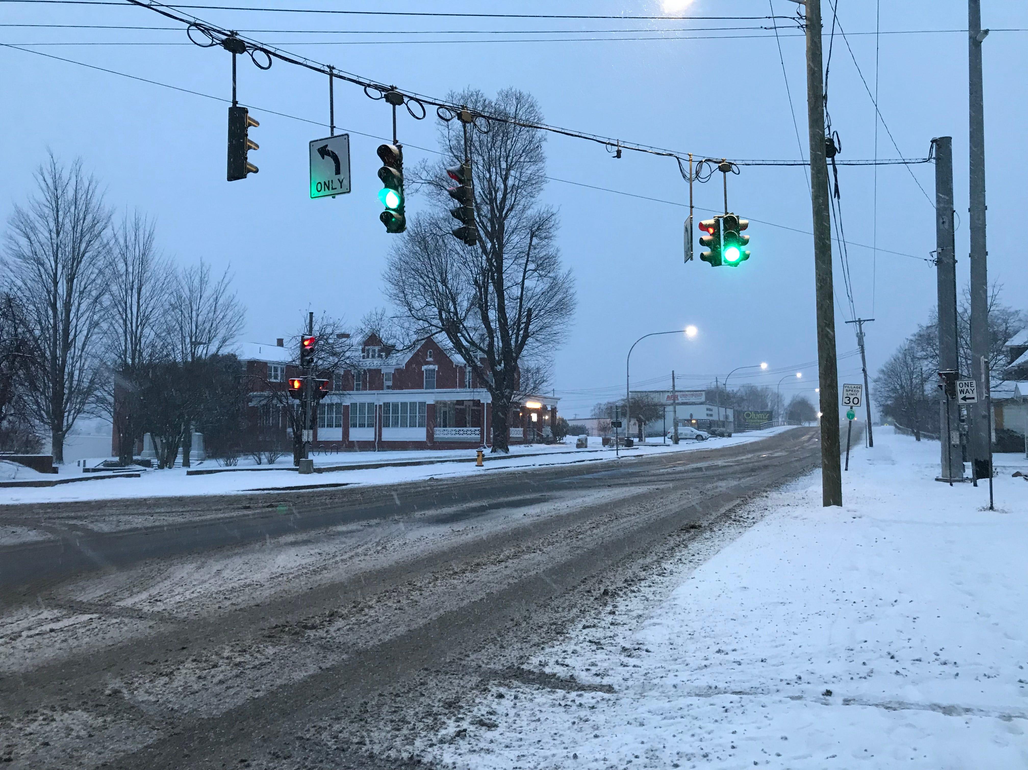 Snowy roads met travelers on Main Street in Johnson City Saturday.