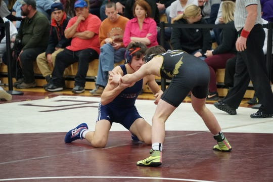 Chenango Forks' Logan Gumble, left, wrestles Corning's Ethan Hart in a 138-pound semifinal in Friday's STAC meet at Johnson City. Gumble won by pin and went on to win his first conference title.