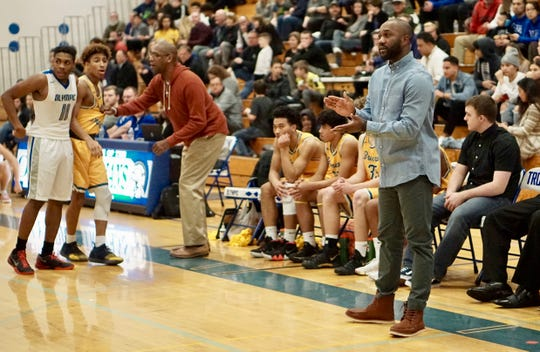 Bremerton boys basketball coach Miah Davis (right) led the Knights to playoff berths in his first two seasons in 2014-15 and 2015-16.