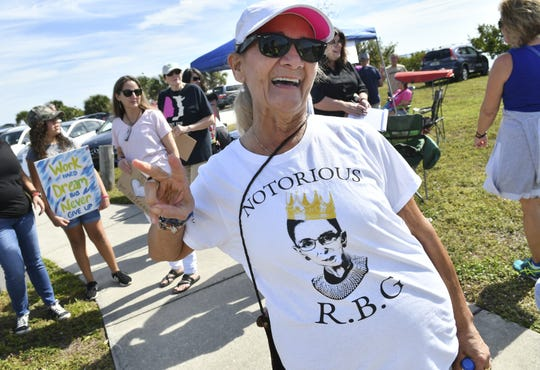 Edie Felton participates in Melbourne's Women's March along the Eau Gallie Causeway Saturday. Hundreds of people walked the Eau Gallie Causeway in Melbourne during a local observance of the national march.