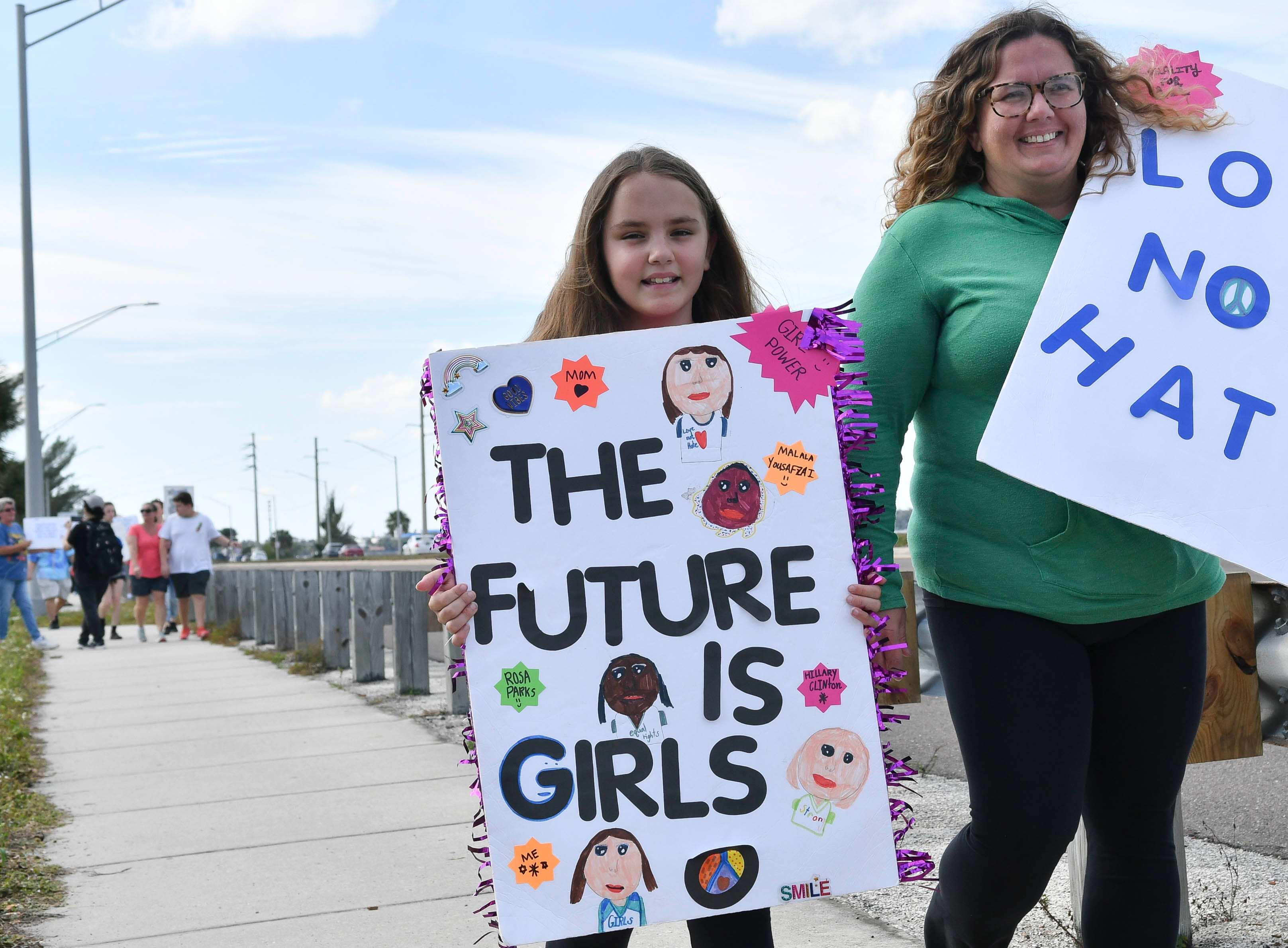 Gabby and April Bohager of Indian Harbor Beach join hundreds of people to walk the Eau Gallie Causeway in Melbourne during a local observance of the national Women's March.