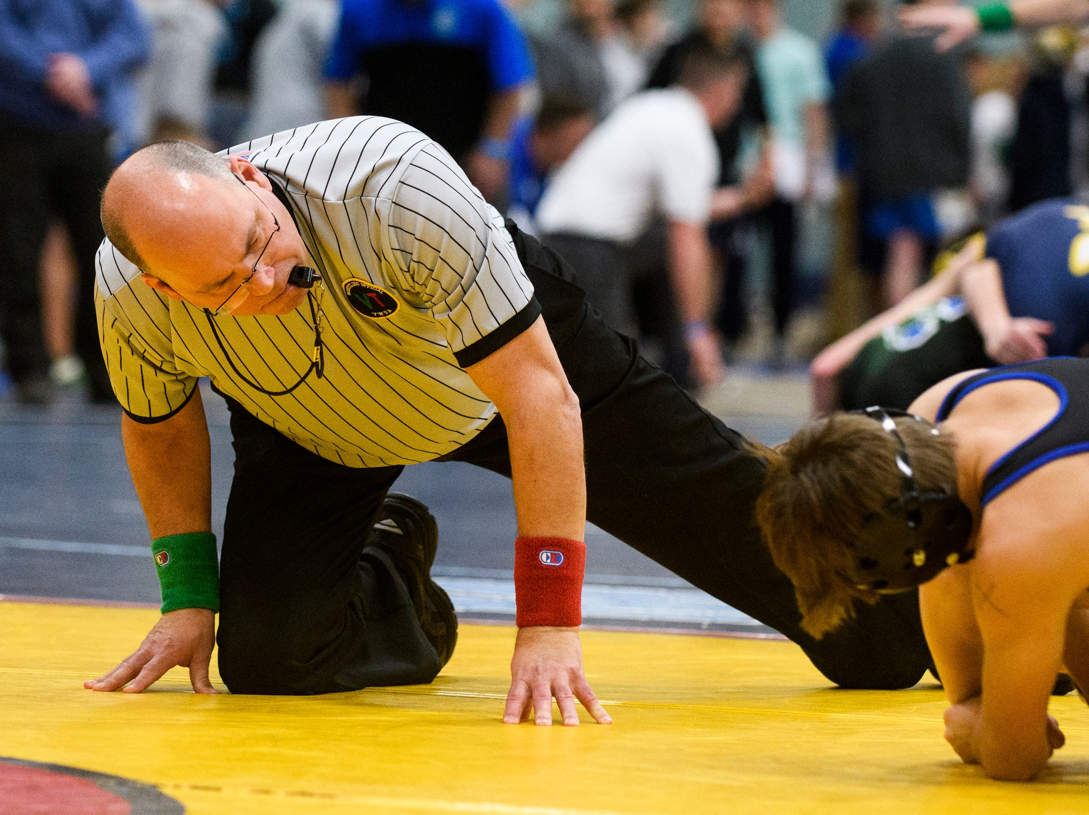 A referee looks for a pin down during the Michael J. Baker Essex Classic wrestling tournament at Essex High School on Friday afternoon January 18, 2019 in Essex, Vermont.