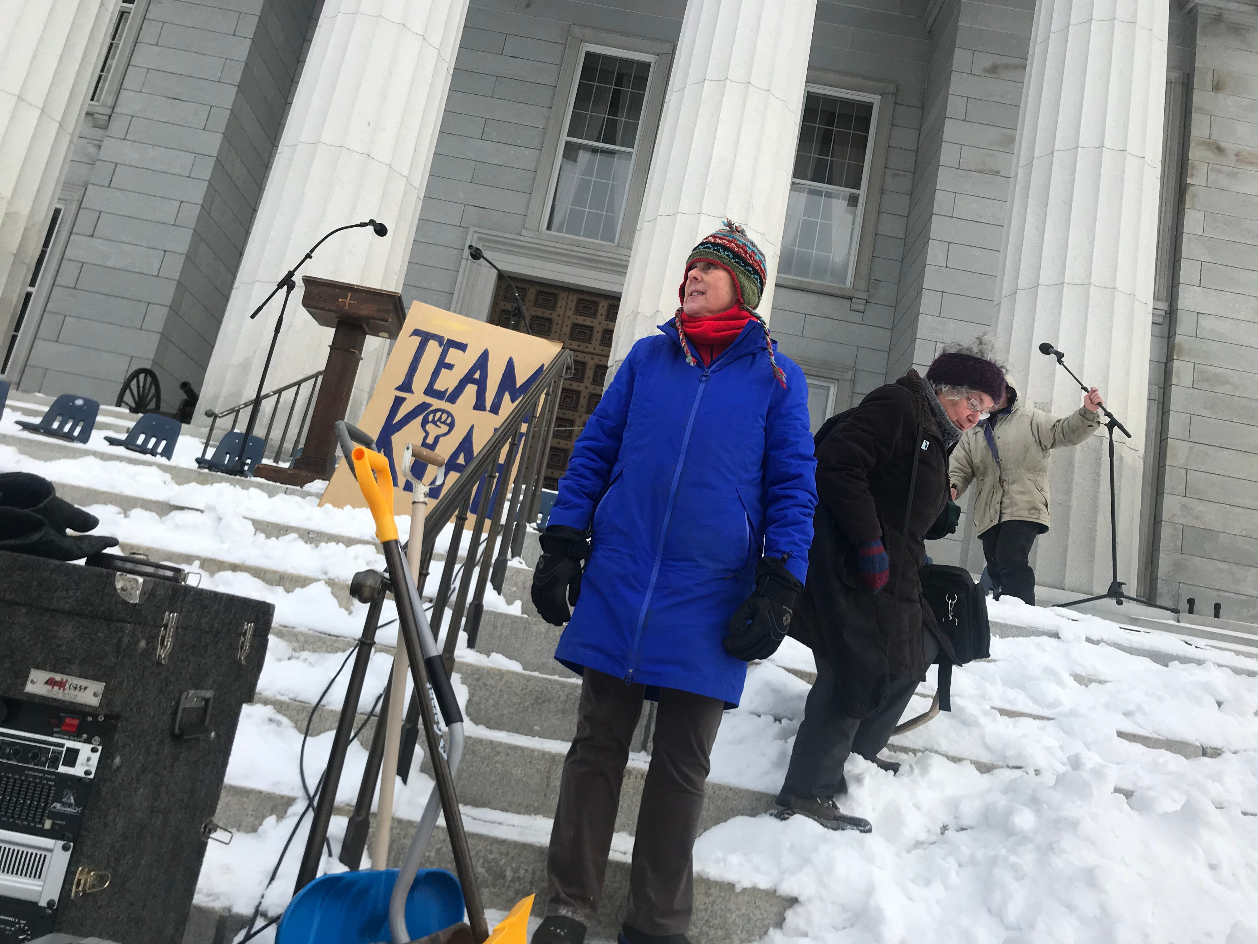 Jo Sahel Courtney, organizer of the Women's March VT, starts setting up on the steps of the capital in Montpelier on Saturday morning, Jan. 19, 2019. Temperatures were in the low single digits.