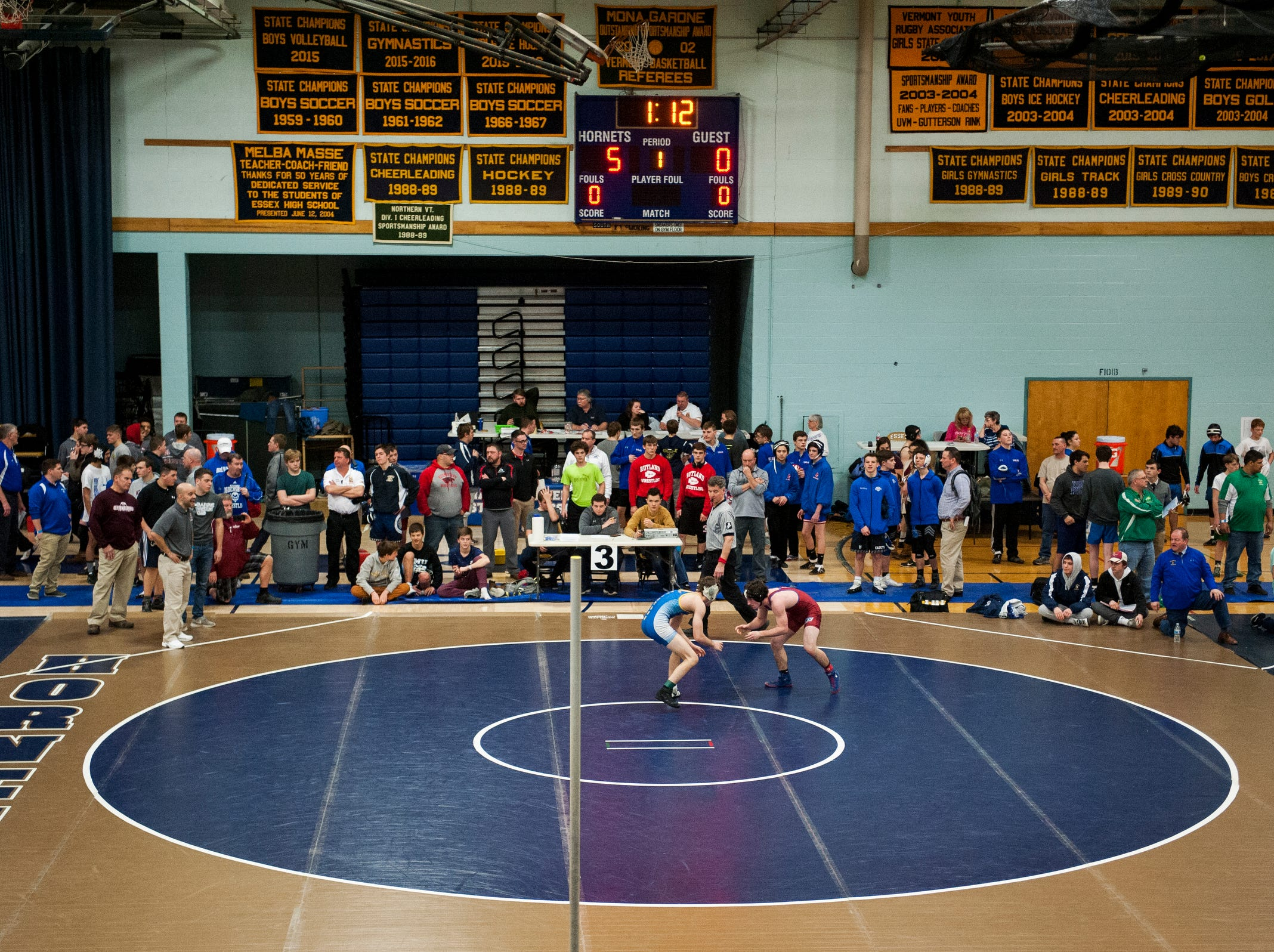 Coaches, teammates and parents watch the wrestling match during the Michael J. Baker Essex Classic wrestling tournament at Essex High School on Friday afternoon January 18, 2019 in Essex, Vermont.