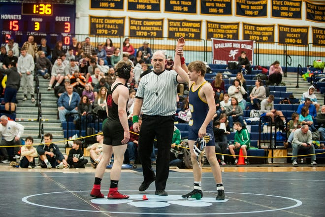 Essex's Eli Bonning wins the wrestling match with CVU's Jacob Graveline during the Michael J. Baker Essex Classic wrestling tournament at Essex High School on Friday afternoon January 18, 2019 in Essex, Vermont.