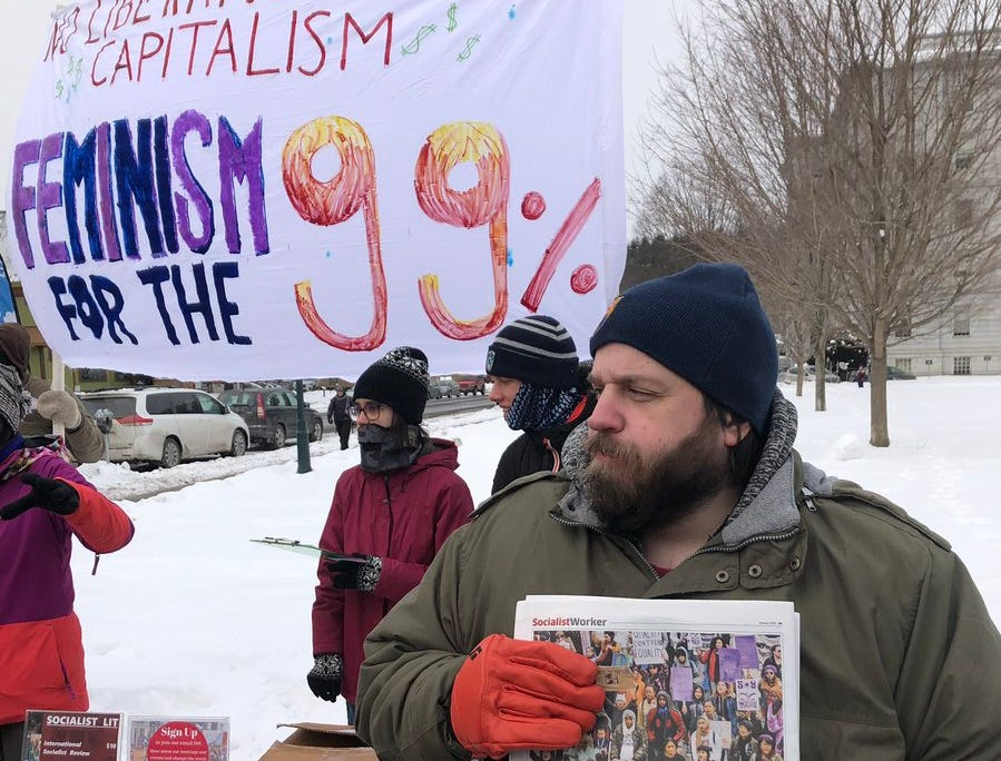"Members of the International Socialist Organization passed out literature on Saturday, Jan. 19,2019, at the Women's March at the Statehouse in Montpelier, Vt. ""We're trying to build an anticapitalist sector of the women's movement in response to some of the corporate feminism you see. Sheryl Sandberg, stuff like that,"" said member Steve Ramey."