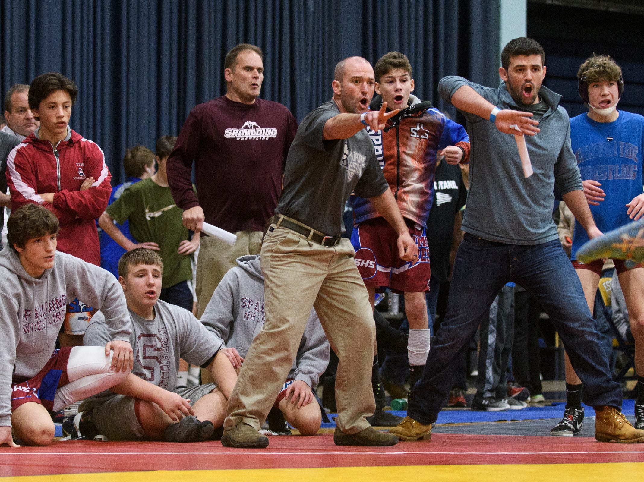 The Spaulding catches and team cheer for Carter Dickerson during the Michael J. Baker Essex Classic wrestling tournament at Essex High School on Friday afternoon January 18, 2019 in Essex, Vermont.