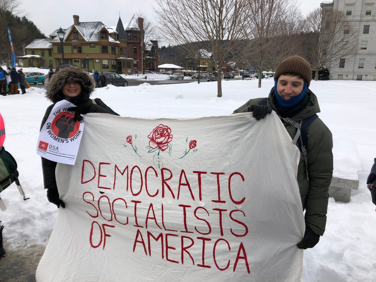 "Members of a local Democratic Socialists chapter were part of the Women's March at the Statehouse in Montpelier, Vt., Saturday, Jan. 19, 2019. ""It's always important to bring your politics to a big coalition and meet people where they are,"" said Walter Keady, from Burlington."